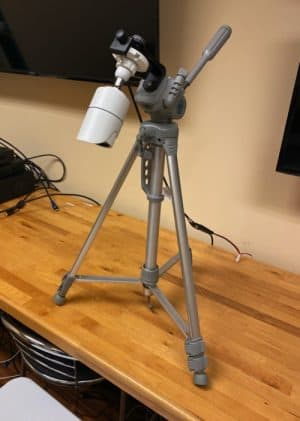 security camera attached to tripod